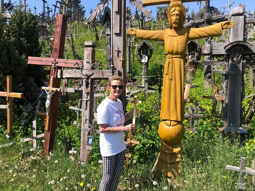 Placing a cross at Hill of Crosses Lithuania