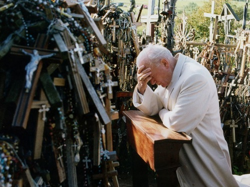 Pope John Paul II prays in Papal visit 1993 at the Hill of Crosses Siauliai, Lithuania.